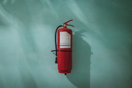 A fire extinguisher on a wall unused